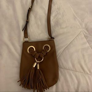 Caramel colored over the shoulder bags